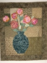 Quilted wall hanging with raised flowers in Houston, Texas