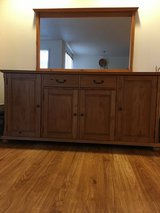 Buffet cabinet with hanging mirror in Fort Lewis, Washington