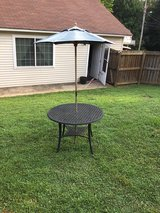 Black Wrought Iron Table w/ Umbrella in Clarksville, Tennessee