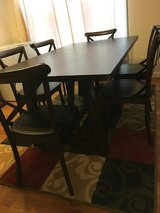 Dining table and chairs in Fort Lewis, Washington