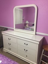 white wooden dresser and mirror in Las Vegas, Nevada