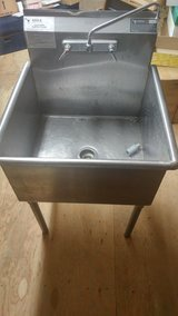 Large stainless steel laundry tub with faucet in Aurora, Illinois