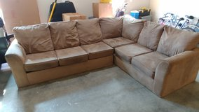 Sectional couch w/ pull out bed in Fort Leonard Wood, Missouri
