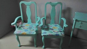 Pair of nautical dining chairs with custom upholstered fish print cushions in Wilmington, North Carolina