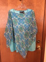 Teal patterned top by Maggie Barnes in Chicago, Illinois