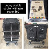 Joovy double stroller with rain cover in Ramstein, Germany