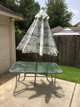 Table with umbrella in Houston, Texas