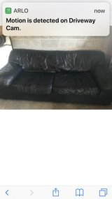 Black Italian leather couch in Pleasant View, Tennessee