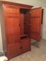 Large armoire/TV cabinet.  Very heavy and well made in Westmont, Illinois