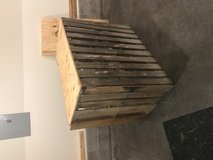 Pallet wood bar with deck wood shelf and plywood top in Fort Campbell, Kentucky
