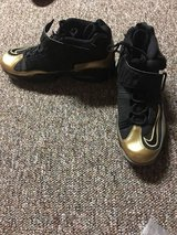 Black and Gold Nike in Joliet, Illinois