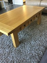 Solid oak coffee table with drawer in Lakenheath, UK