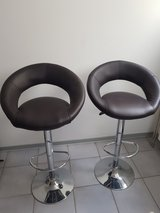Two dark brown bar stools in Ramstein, Germany
