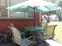 Patio table chairs and umbrella in Fort Campbell, Kentucky