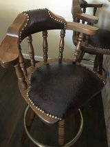 Vintage antique leather bar stools with padding in Yucca Valley, California