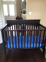 Solid wood baby bed with mattress in Conroe, Texas