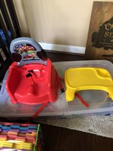 Cars booster seat with tray and safety straps in Conroe, Texas