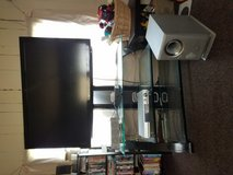 Tv with entertainment stand in Clarksville, Tennessee