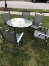 Patio table and folding chairs in Glendale Heights, Illinois