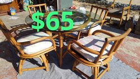 bamboo glass top table and chairs$65 in San Bernardino, California