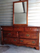 Solid wood dresser with mirror in good condition in El Paso, Texas