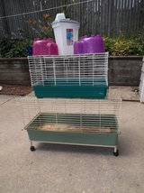 2 cages, 2 cubbies, and  1 food storage container. in Yorkville, Illinois