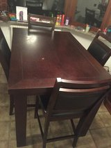 Bar height farm table with chairs in Shreveport, Louisiana