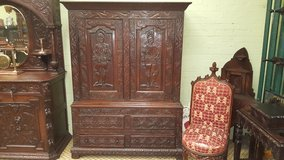Carved Oak Cupboard with Knights Free Delivery in Lakenheath, UK