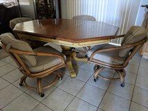 Antique kitchen table and rolling chairs in Vista, California