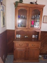 Dinning room Oak cabinet in Fort Campbell, Kentucky