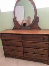 Solid Oak Dresser in Excellent Condition hosts 8 roomy drawers  no nicks scratches or discoloration in Lockport, Illinois