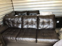 Brown leather sectional in Perry, Georgia