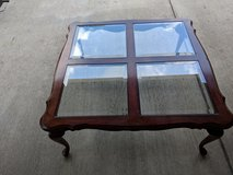 Cherry coffee table with glass inserts in Kansas City, Missouri