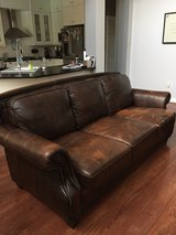 Beautiful brown leather couch, loveseat, reclining chair and ottoman in Kingwood, Texas