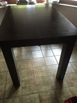 Bar height solid table in Shreveport, Louisiana