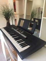 Piano/ Yamaha PSR E243, plus music rest, sustain peddle, headphones, stand and seat in Kingwood, Texas