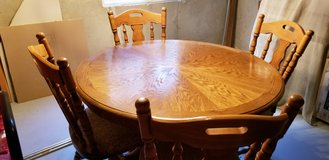 Five piece oak dining set in Chicago, Illinois