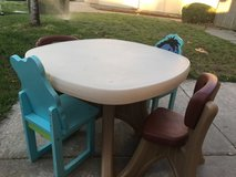Step 2 Kids table with a total of 4 chairs 1 is a Pooh and Eeyore chair in Travis AFB, California