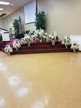 Wedding floral arrangements, 20 pew bouquets and bridesmaids bouquets in Naperville, Illinois