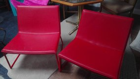 Pair of red chairs vinyl. in Wilmington, North Carolina