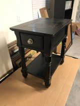 Black coffee table and end table in Conroe, Texas
