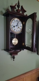 small grandfather clock chimes hour and half hour wind up 31 days in Chicago, Illinois