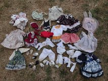 Mixed lot china dolls clothes.shoes in Lakenheath, UK