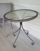 IRON AND GLASS PATIO/DECK TABLE (solid and pretty) in Fort Leonard Wood, Missouri