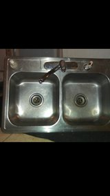 stainless steel kitchen sink with moen faucet and sprayer in Louisville, Kentucky