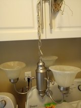 three frosted globe and brushed nickel chandelier in Lake Charles, Louisiana