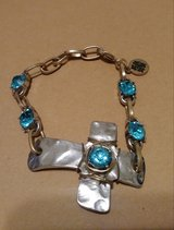 Blue stone cross bracelet in Bellaire, Texas