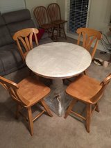 Corian top table with four matching chairs in Brookfield, Wisconsin
