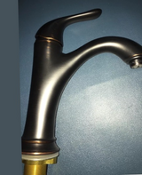 Single lever oil rubbed bronze bathroom faucet in Beaufort, South Carolina