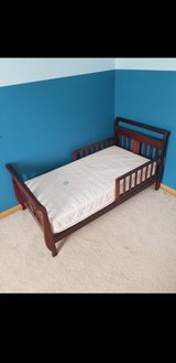 Cherry wood sleigh toddler bed with mattress in New Lenox, Illinois